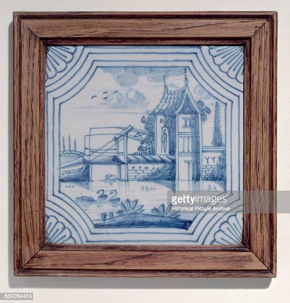 A 19th century tile showing a drawbridge over a canal from the city of Delft Netherlands | Location near Delft Netherlands
