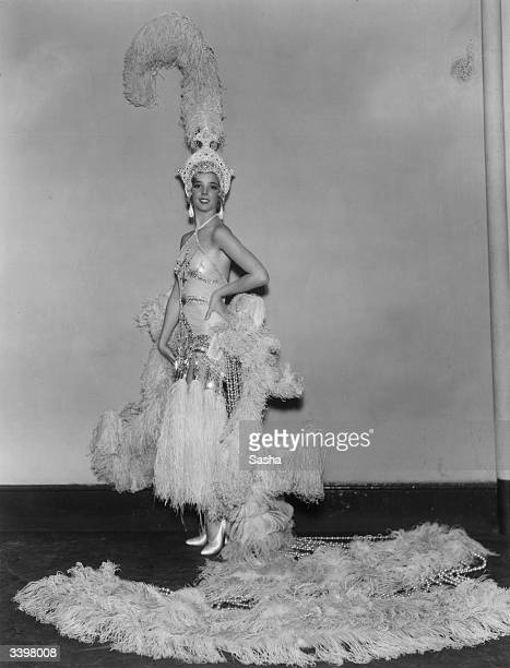 British actress Jessie Matthews wearing one of her exotic costumes for Cochran's new musical 'Evergreen' at the Adelphi Theatre London