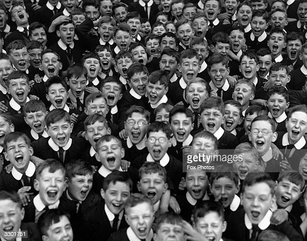The boys of Reedham Orphanage in Purley Surrey give a cheer on the day they break up for their Christmas holidays