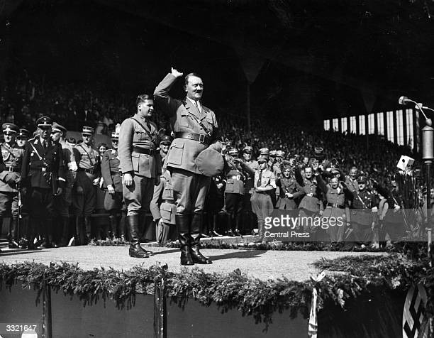 German chancellor Adolf Hitler salutes a crowd of 60000 at a Hitler Youth rally at Nuremberg