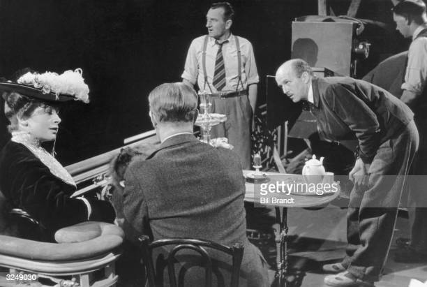 Michael Powell directs Deborah Kerr and Roger Livesey in the film 'The Life and Death of Colonel Blimp' Original Publication Picture Post 1239...