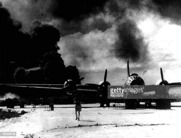 Japanese bombers raid a B29 Superfortress base on Saipan in the Mariana Islands
