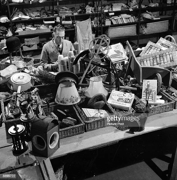 A British transport lost property office with some of the assorted articles which have been left on trains or buses Original Publication Picture Post...