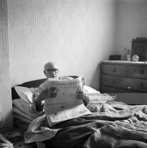 A man reading the 'News of the World' in bed on a sunday morning Original Publication Picture Post 6834 The Best And Worst Of Britain Ours Is A Land...