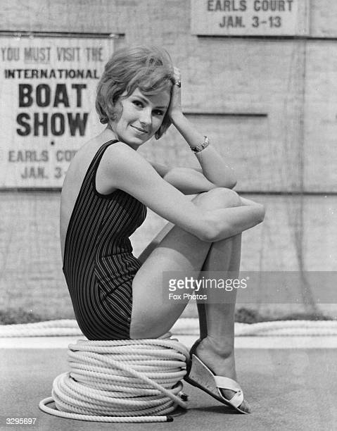 A model sitting on a coiled nylon rope models a BriNylon swimsuit designed by Slix which has a low scooped back It is one of the fashions in the...