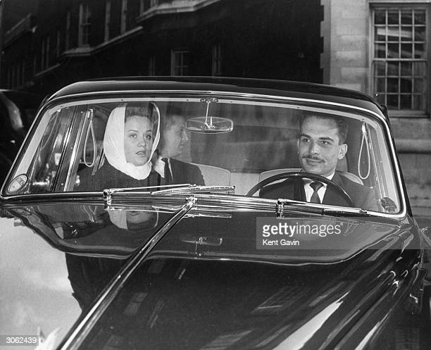 King Hussein I of Jordan and his second wife Britishborn Princess Muna set off for a lunch engagement with Queen Elizabeth II during a visit to London
