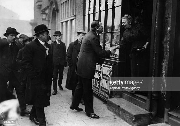 Major Wilson the Unionist Party Candidate canvassing on Polling Day during the Bye Election in Bethnal Green