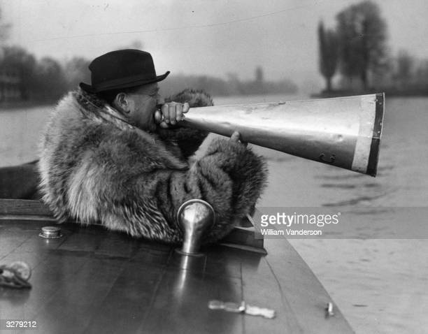 Mr HaigThomas trainer of the Oxford boat crew braves the chilly weather during training well wrapped up in a fur coat