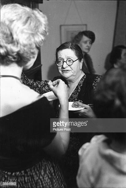 Eleanor Farjeon revue-writer, children's novelist and poet at a party given by the British PEN Club. Original Publication: Picture Post - 4722 -...