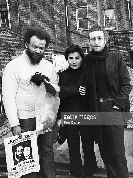 ExBeatle John Lennon and his wife artist Yoko Ono give their newly cut hair to black power leader Michael X in return for a pair of Muhammad Ali's...