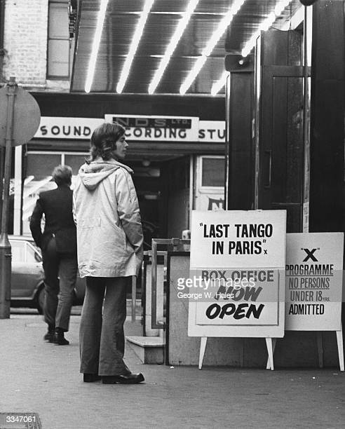 A young man outside The Prince Charles Cinema in Leicester Square London where the controversial 'X' rated film 'Last Tango In Paris' is being shown