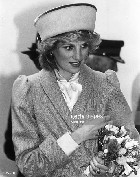 Diana, Princess of Wales during an official visit to Derby. Her sapphire and diamond engagement ring can be seen on her left hand.