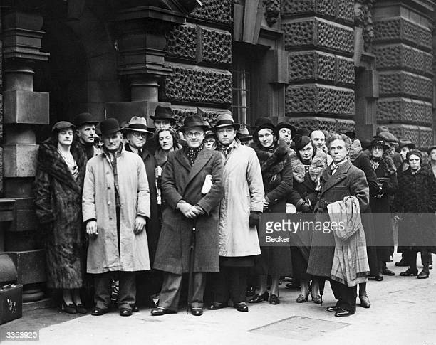 A queue outside the Old Bailey London where the case of the three Welsh Nationalists accused of setting fire to the RAF aerodrome near Pwelheli...