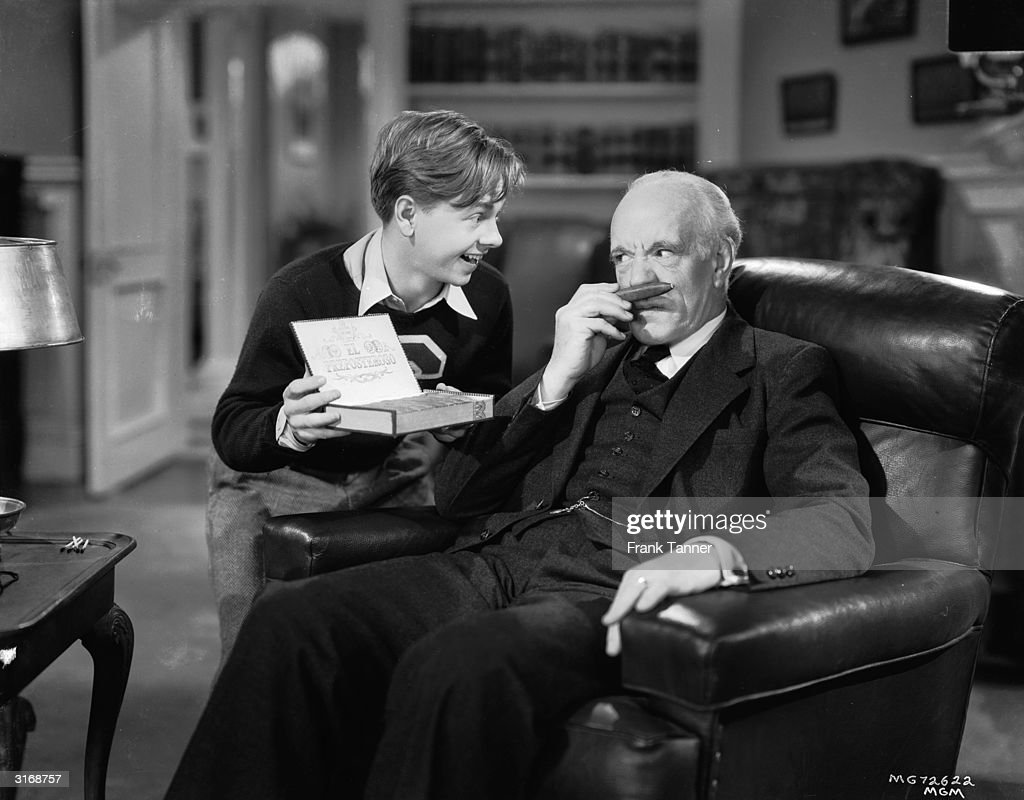 Mickey Rooney and Lewis Stone (1879 - 1953) in a scene from one of the many films based around the character Andy Hardy.