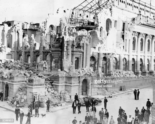 British and American navy and merchantmen mix with residents of Malta outside the shattered Opera House following massive air attacks by Axis forces