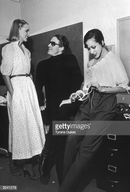 American fashion designer Halston talks with models before a summer collection show in New York City.