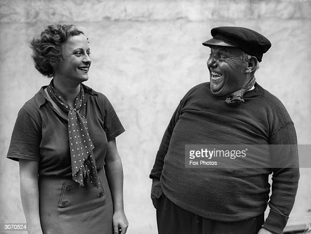 Hollywood actress Renee Gadd shares a joke with Fred Bevan at Ealing's Associated Talking Pictures Studio