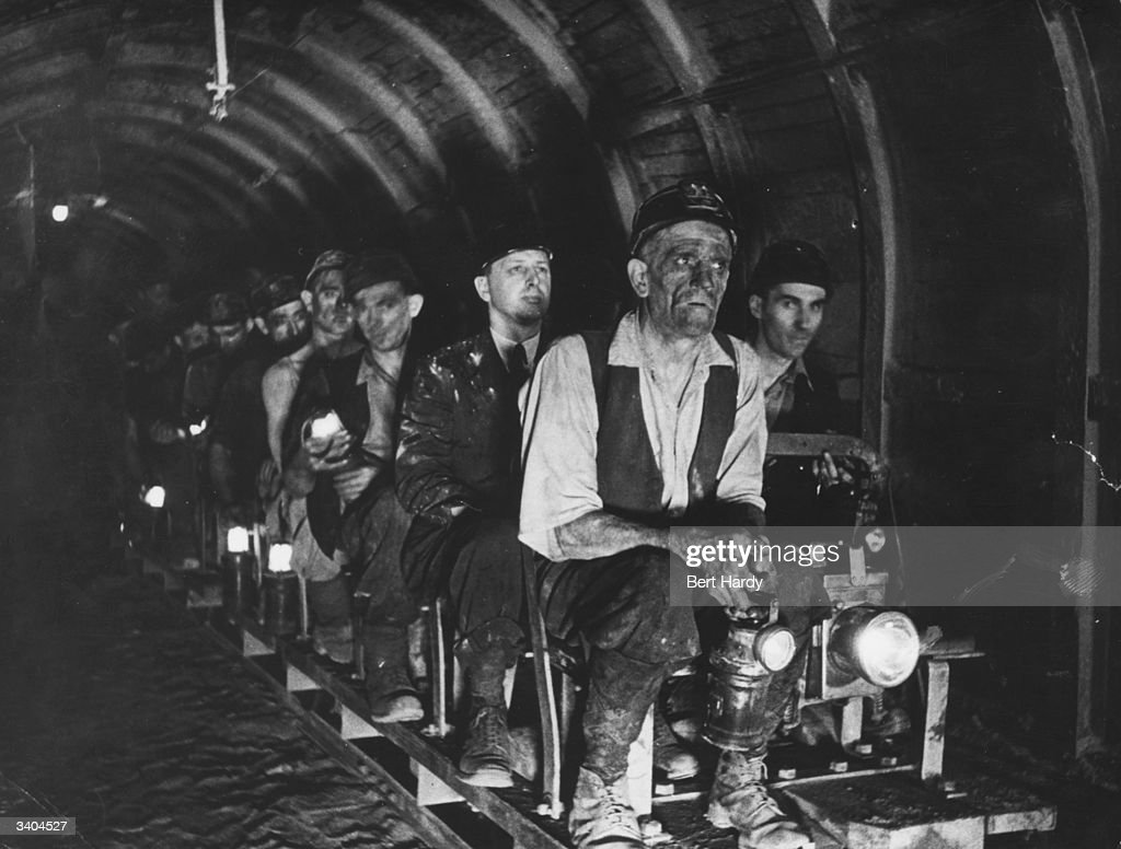 Coal miners are conveyed the long distance to the pit face by rail at Mere Grove, Armthorpe, near Doncaster. Original Publication: Picture Post - 799 - This Problem Of Coal - pub. 1941