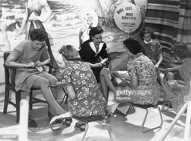 Ladderless stockings being painted onto ladies' legs in Croydon Surrey as part of wartime rationing initiatives