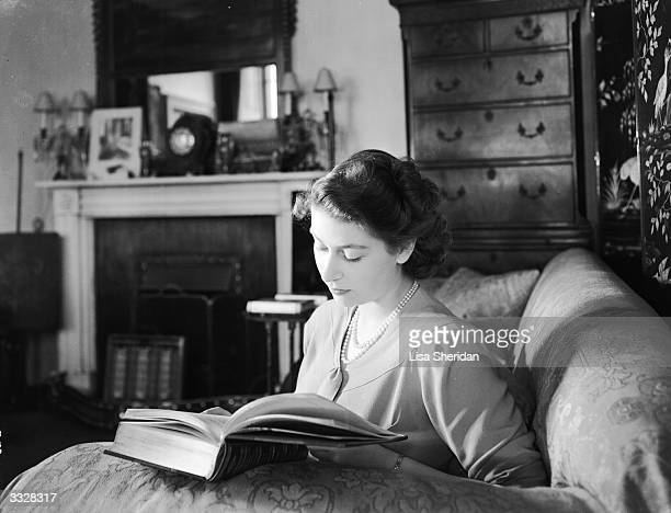 Princess Elizabeth reading in her apartment at Buckingham Palace London