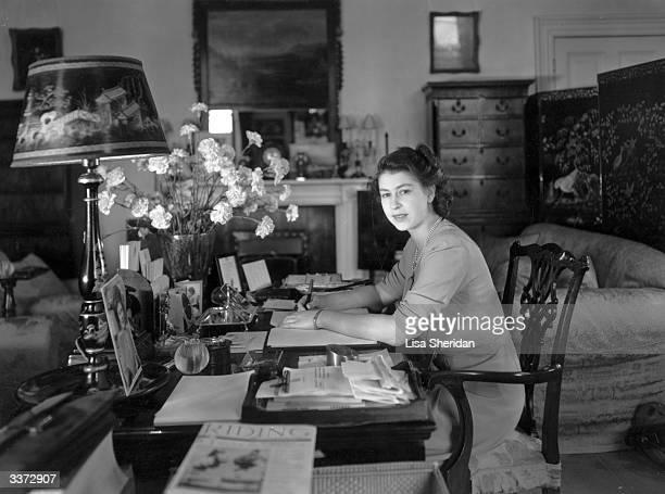 Princess Elizabeth working at her desk in Buckingham Palace.