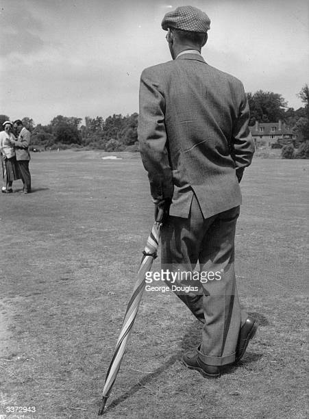 A spectator relaxing between holes at the Daks tournament played at Wentworth a fortnight before the Open Championship Original Publication Picture...