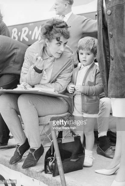 Bette, the wife of British racing driver Graham Hill at Silverstone race track with their son Damon.