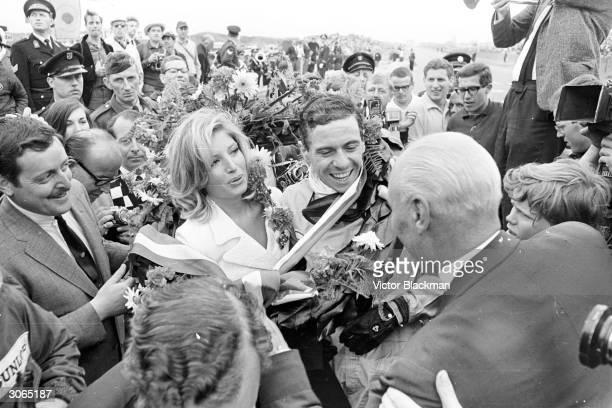 Scottish racing driver Jim Clark being congratulated by the Italian actress Monica Vitti after winning the Dutch grand prix.