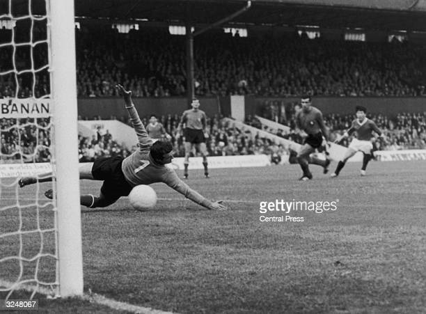 Italian goalkeeper Enrico Albertosi fails to save a shot from North Korean forward Pak Doo Ik during North Korea's World Cup match against Italy at...
