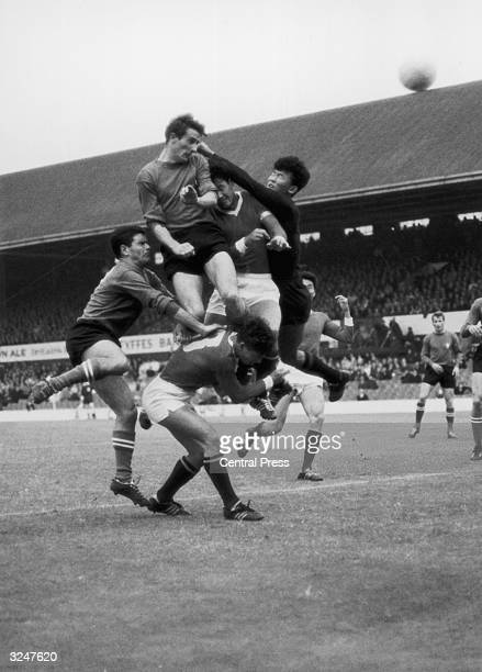 Li Chan Myung the North Korean goalkeeper clears the ball from Fogli and Perani of Italy during a World Cup match in Middlesbrough Korea won the...
