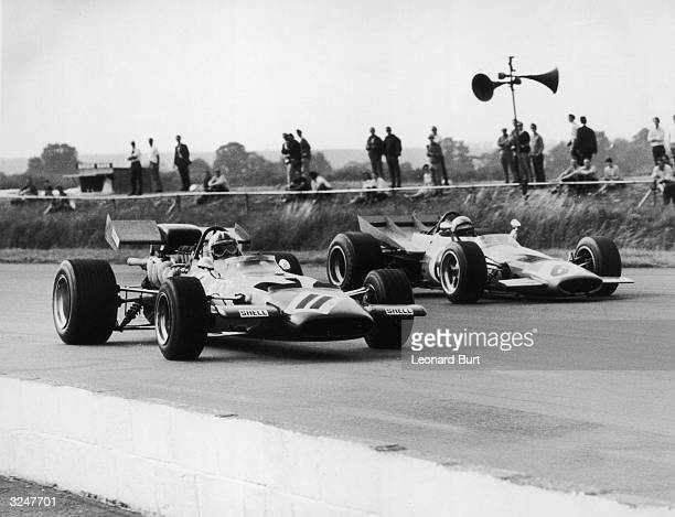 New Zealanders Chris Amon and Bruce McLaren during practice for the British Grand Prix at Siverstone.
