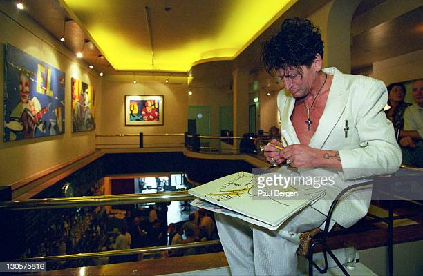Dutch singer and artist Herman Brood sits drawing in Cafe Dante in Amsterdam Netherlands on 19th July 1997