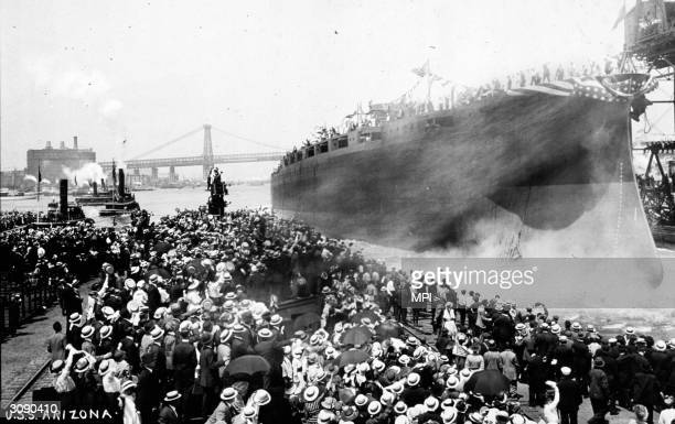 The launch of the warship 'USS 'Arizona' at the New York Navy Yard The ship was destroyed during the raid on Pearl Harbour and lost over one thousand...