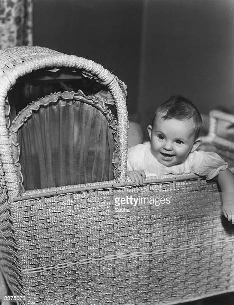Robin Anne Colton baby daughter of British character actress Enid StampTaylor at home in her cradle at Maida Vale London
