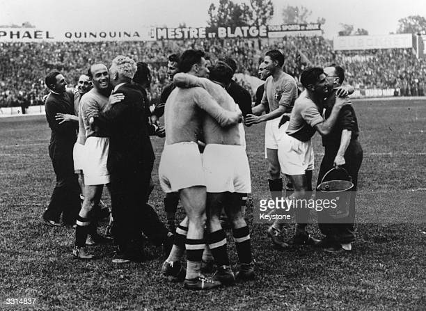 Members of the Italian football team embracing each other at the end of their 42 victorious World Cup final against Hungary in Paris