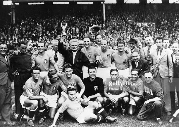 The victorious players of the Italian national football team hold the 1938 World Cup trophy after their 42 win over Hungary in the FIFA World Cup...