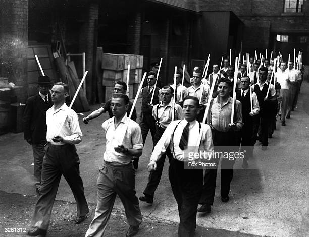 The Civicorps with sticks in place of rifles taking part in a marching drill during training at Doncaster. The Civicorps consists of men who are...