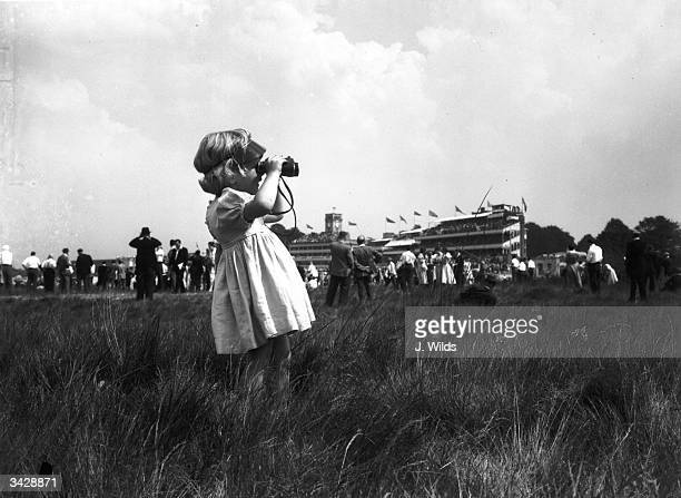 Two year old Pamela Brown watching the racing during the first day of the Royal Ascot races