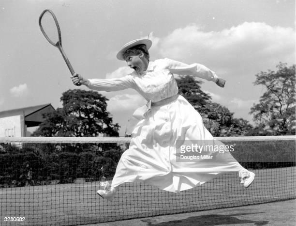 American tennis player Darlene Hard wearing a period tennis dress at a preWimbledon Tennis party at the Hurlingham Club London