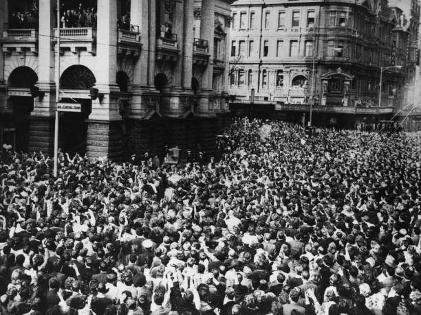 Huge crowds surrounding The Beatles on tour 'down-under'...