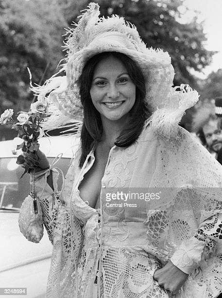 Erotic actress Linda Lovelace is a picture of oldfashioned charm in lace and roses at Ascot