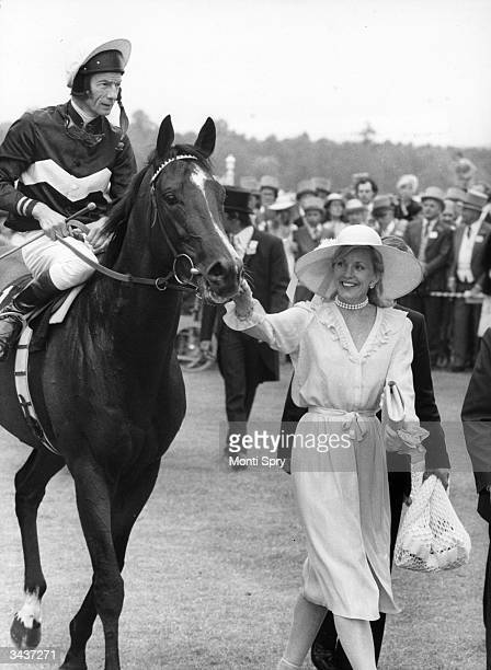 Mrs St George leads in her husband's horse 'Ardross' after it won the Gold Cup at Royal Ascot Lester Piggott up