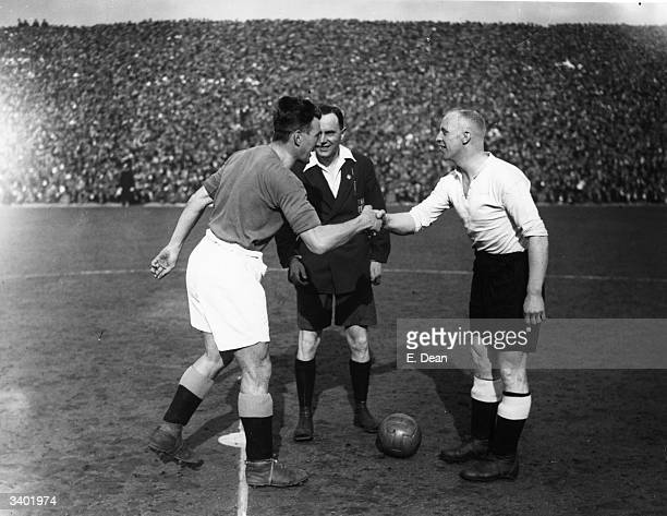Manchester City and Derby County captains Cowan and Cooper shake hands in front of referee J W Lucas beforer the kick off of an FA_Cup semifinal at...
