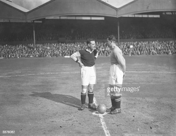Victor Watson captain of West Ham United and Dixie Dean captain of Everton in the centre circle before the start of their FA Cup semifinal match at...