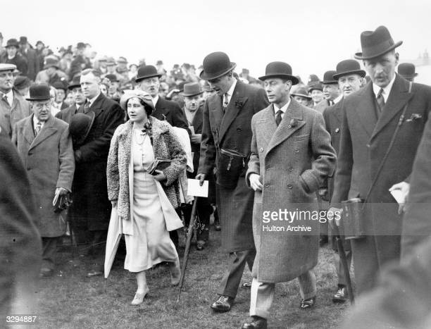 King George VI and Queen Elizabeth in the paddock at Aintree during the Grand National horse race