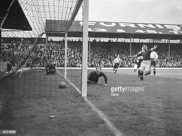 Brentford goalkeeper Crozier watches Chelsea's first goal go over the line scored by Spence during a match at Brentford
