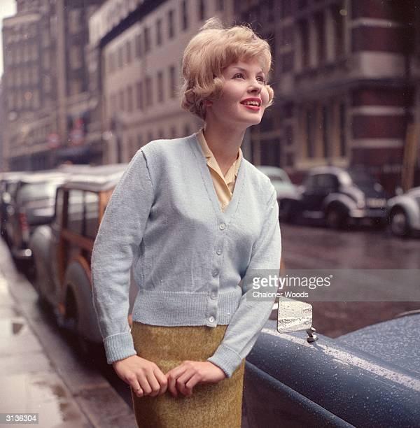 Fine wool classical cardigan in pale blue stocking stitch. Bestway Knitwear
