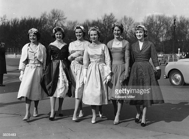 A group of debutantes arriving at Buckingham Palace London for a presentation party From left to right they are Sally O'Rorke Julia Chatterton...