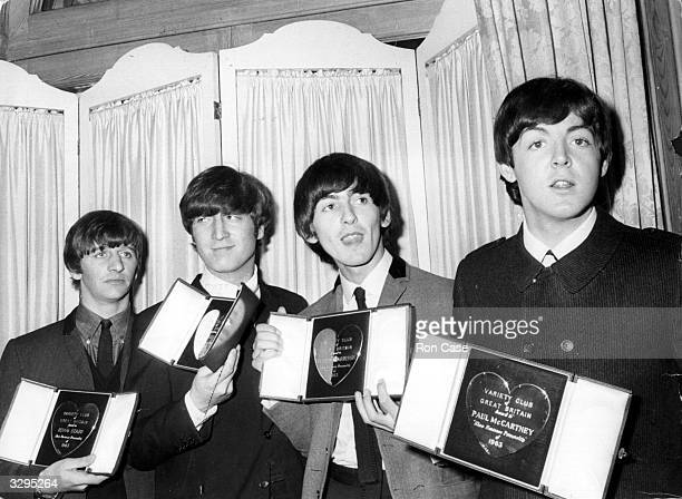The Beatles holding their awards at the Variety Club of Great Britain annual Show Business Awards presentation at the Dorchester Hotel London The...
