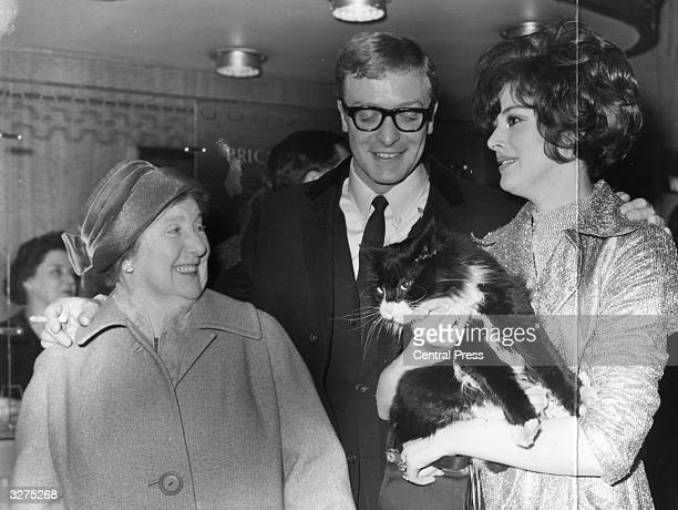 Michael Caine originally Maurice Micklewhite British film actor with his mother and his leading lady Sue Lloyd attending a film premiere of 'The...